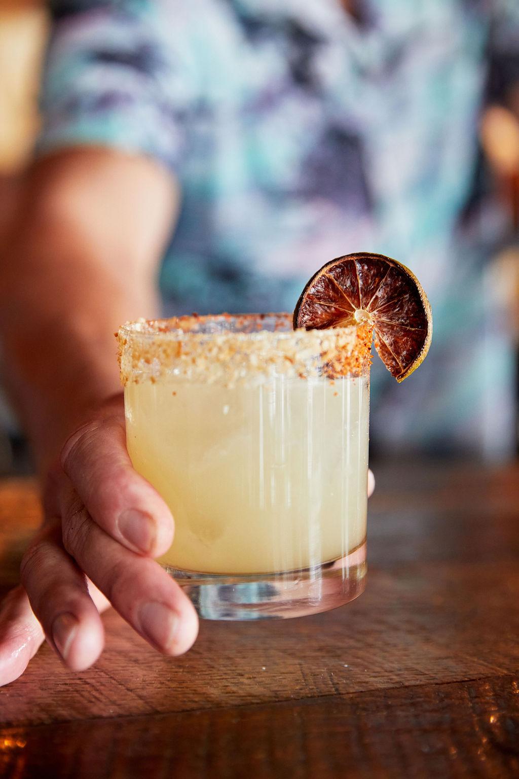 Bartender serving our Gringo Lingo cocktail