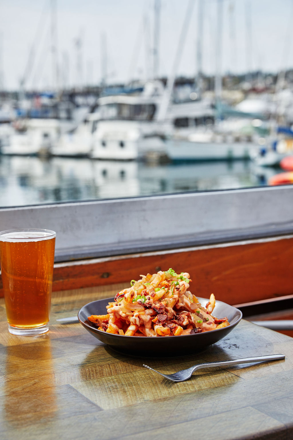 Enjoy a beer and smothered fries at Jimmy's San Diego